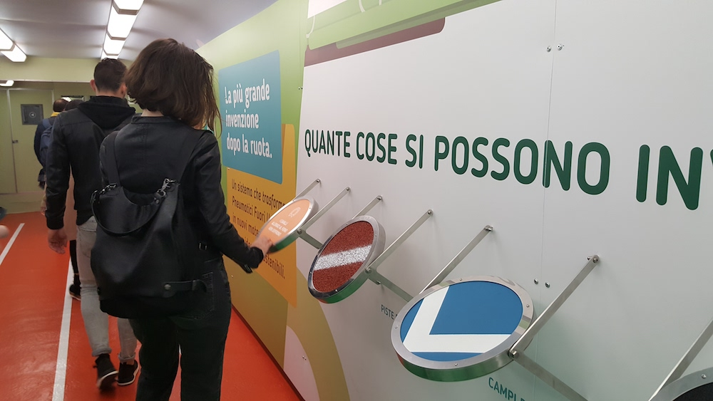 The Ecopneus car of recycled rubber on the GreenTrain reaches Turin